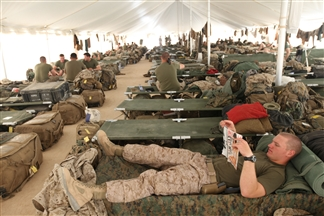 U.S. Marines with 1st Battalion, 5th Marine Regiment relax at Camp Leatherneck, Afghanistan